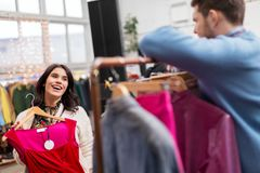 Couple choosing clothes at vintage clothing store Royalty Free Stock Photo