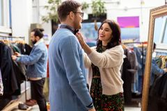 Couple choosing clothes at vintage clothing store stock photography