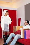 Couple choosing coat at shop Royalty Free Stock Images