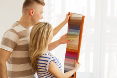 Couple choosing color for their new apartment Royalty Free Stock Photos