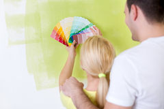 Couple choosing color in their new house Royalty Free Stock Image
