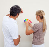 Couple choosing a color to paint a room. After move in Stock Photo
