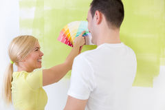 Couple choosing a color to paint a room Royalty Free Stock Images