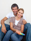 Couple choosing color to paint their new house. Smiling couple choosing color to paint their new house Royalty Free Stock Image