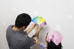 Couple Choosing Colors For Painting House Stock Photography