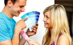 Couple choosing a colour to  paint Stock Images