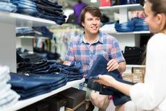 Couple choosing denim in store Stock Photo