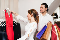 Couple choosing  dress at boutique Royalty Free Stock Images