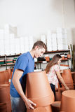 Couple choosing flower pots. Couple buying some flower pots stock photo