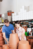 Couple choosing flower pots. Couple buying some flower pots stock image
