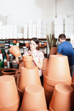 Couple choosing flower pots. Couple buying some flower pots stock photography