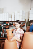 Couple choosing flower pots. Woman buying some flower pots stock photo