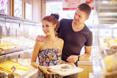 Couple choosing food in a shop Stock Photography