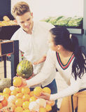 Couple choosing fruits in shop royalty free stock photo