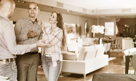 Couple choosing furniture in salon stock images