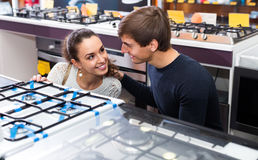 Couple choosing gas hobs Royalty Free Stock Image
