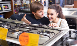 Couple choosing gas hobs Stock Image
