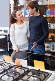 Couple choosing gas hobs Stock Photo