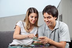 Couple Choosing Glass Tile Swatches royalty free stock photo