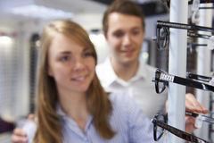 Couple Choosing Glasses In Opticians Royalty Free Stock Image