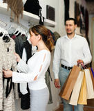 Couple  choosing gown at boutique Stock Images