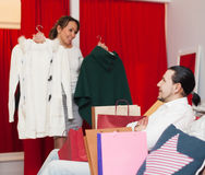Couple choosing jacket at clothing store Stock Images