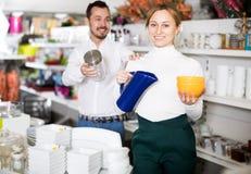 Couple choosing new crockery in dinnerware store Stock Photography