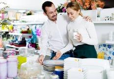 Couple choosing new crockery in dinnerware store Royalty Free Stock Image
