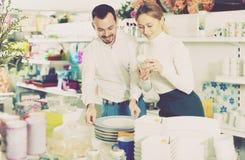 Couple choosing new crockery in dinnerware store Stock Photos
