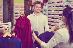 Couple choosing new sportswear in sports store Stock Photography