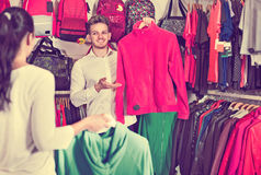 Couple choosing new sportswear in sports store Royalty Free Stock Photo