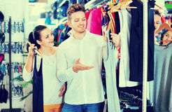 Couple choosing new sportswear in sports store Royalty Free Stock Image