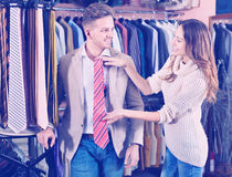Couple choosing new tie in men's cloths store Royalty Free Stock Photo