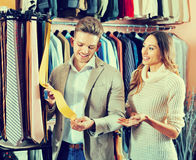 Couple choosing new tie in men's cloths store Stock Image