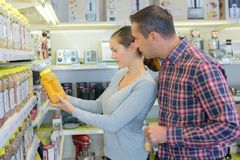 Couple choosing oil in kitchen appliance shop. Cooking stock photography