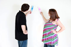 Couple choosing paint color Royalty Free Stock Photography