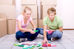 Couple choosing paint colors Royalty Free Stock Photo