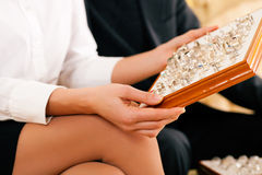 Couple choosing a ring at the jeweller stock image