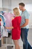 Couple Choosing Shirts In Store Stock Photos