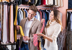 Couple choosing tie in store Royalty Free Stock Image