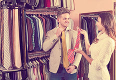 Couple choosing tie in store Stock Images