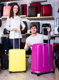 Couple choosing travel suitcase in shop Royalty Free Stock Photo