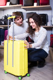 Couple choosing travel suitcase in shop Stock Image