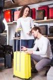 Couple choosing travel suitcase Stock Photo