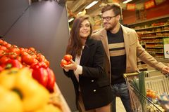 Couple choosing vegetables Royalty Free Stock Photo