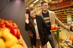 Couple choosing vegetables Stock Image