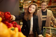 Couple choosing vegetables Stock Photo