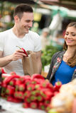 Couple choosing vegetables in grocery store Stock Image