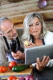 Couple choosing vegetables to cook Royalty Free Stock Photo