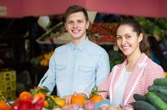 Couple choosing veggies and fruits Stock Photos